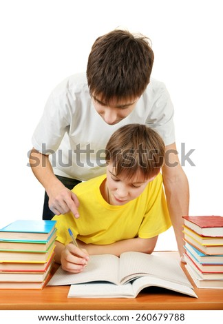 Older Brother and Little Brother doing Homework on the White Background - stock photo