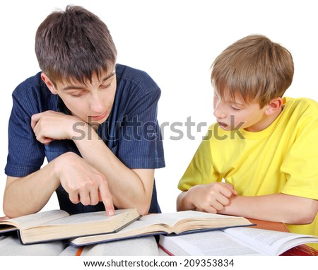 Older Brother helps Little Brother with a homework on the white background - stock photo