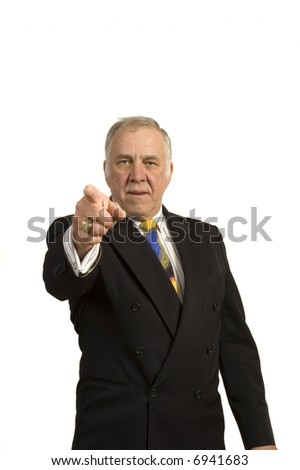 older businessman in a suit, pointing and isolated on white