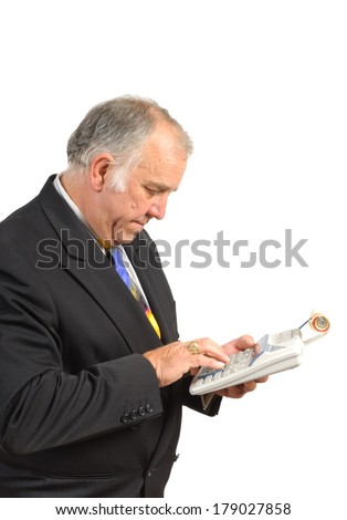 Older businessman or accountant calculating costs isolated on white - stock photo