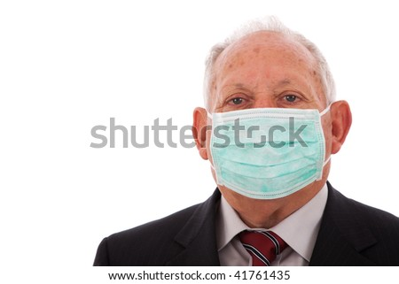 Older businessman protected with a face mask (isolated on white)