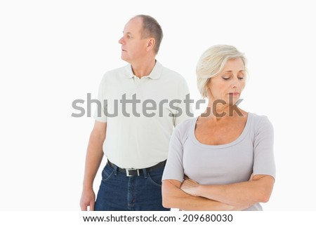 Older couple having an argument on white background - stock photo