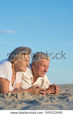 older couple relaxing on a sunny day together