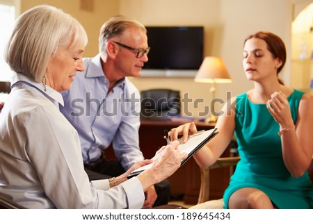 Older Couple Talking To Financial Advisor In Office - stock photo