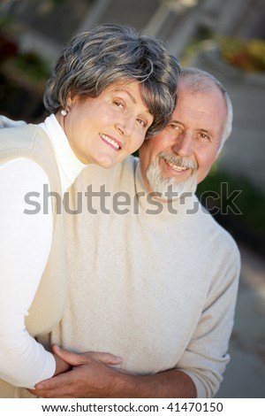 Older couple very much in love holding each other tenderly