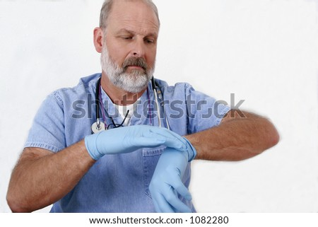 older doctor on white background putting on blue latex gloves