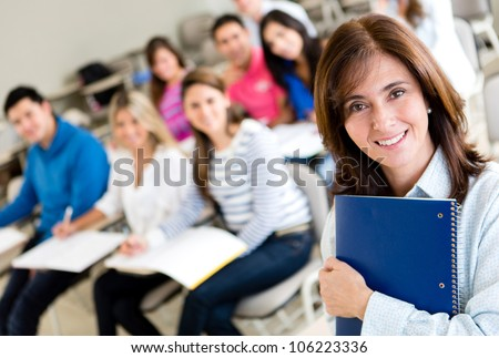 Older female student in class holding a notebook