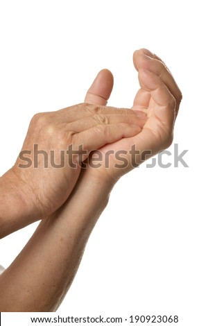 Older hands closeup on a white background - stock photo