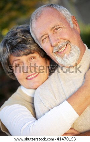 Older husband and wife still absolutely thrilled to be together