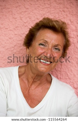 Older lady posing to camera with trusty look - stock photo