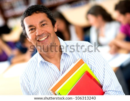 Older male student at the university smiling - stock photo