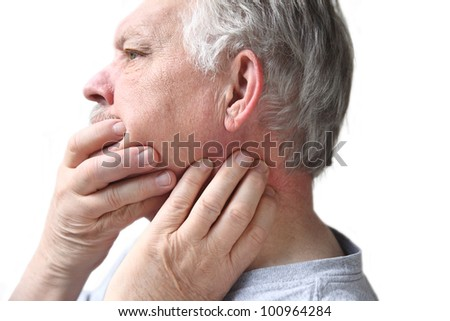 older man has difficulty moving his neck or jaw - stock photo