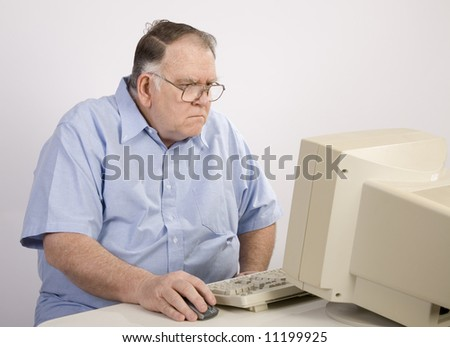 older man surfing the web - stock photo