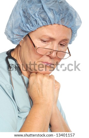 Older nurse sad and depressed at work; isolated on white