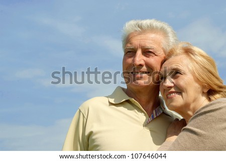 Older people are enjoying the fresh air surrounded by nature - stock photo