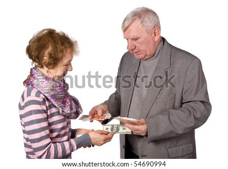 Older persons with money in hands. It is isolated on a white background - stock photo