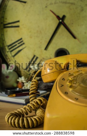 Older phones and background vintage. - stock photo