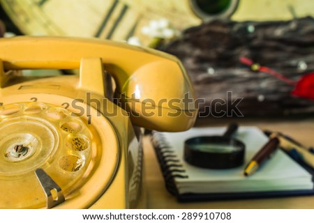 Older phones and stationery on the desk. - stock photo