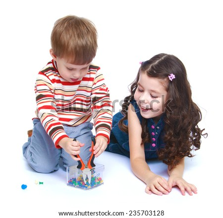 Older sister to look after his younger brother as he plays with a pair of pliers.White background, isolated photo. - stock photo