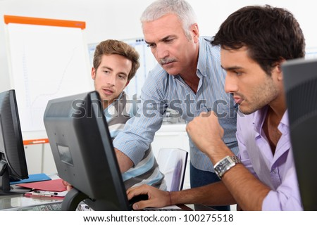 Older students using computers in the classroom - stock photo