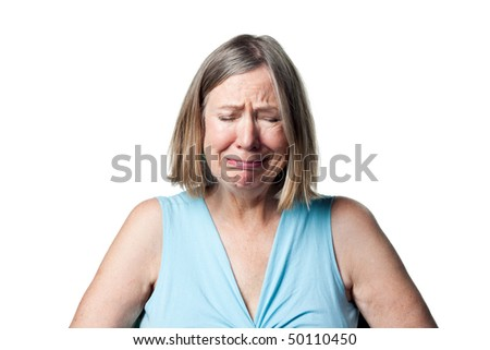 Older woman crying, shedding tears and generally upset - stock photo
