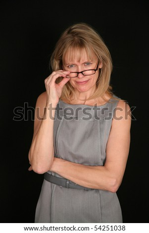 older woman looking over top of glasses - stock photo