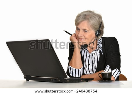 Older woman with a laptop on a white background - stock photo