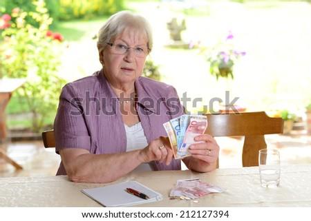 older woman with euros - stock photo