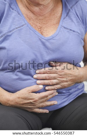 Older woman with stomach ache, pain or injury