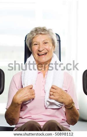 Older woman working out at the gym - stock photo
