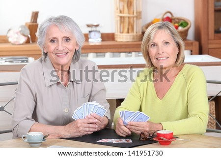 Older women playing cards - stock photo