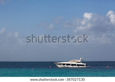 oldest boat of in the tropical lagoon turquoise Caribbean Sea in the Maldivian Hawaiian Bahamas