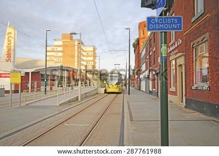 OLDHAM, UK - JUNE 15, 2015: Oldham metrolink station. Oldham Council is investing £400 million  in key regeneration projects including Metrolink - stock photo