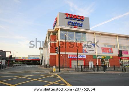 OLDHAM, UK - JUNE 15, 2015: Supermarket, Oldham. Oldham Council is investing £400 million  in key regeneration projects including Metrolink - stock photo