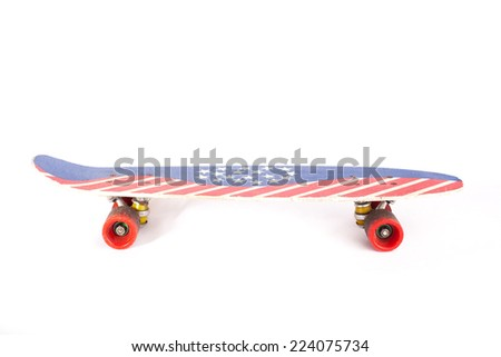 Oldschool Skateboard with USA flag on top - stock photo