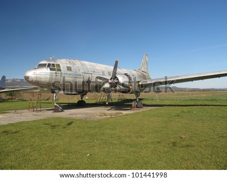 Oldtimer aircraft on airport - stock photo