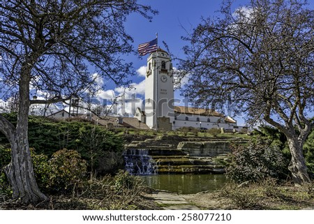 Ole white Depot with park and waterfall - stock photo