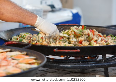 OLHAO, PORTUGAL - AUG 11: Workers cooking seafood at seafood event on August 11, 2012 in Olhao, Portugal.