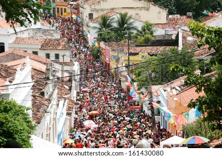 OLINDA, BRASIL - FEB 19: People celebrating the frevo carnival on February 19, 2012 in the old town of Olinda, Pernambuco, Brasil. - stock photo