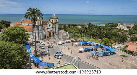 OLINDA, BRAZIL - APRIL 1: Aerial view of Olinda in PE, Brazil showing the historic Se Church and handicraft street vendors at the historic site of the city photographed on April 1, 2014. - stock photo