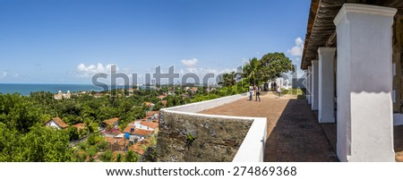 OLINDA, BRAZIL - APRIL 28: Panorama of Olinda in PE, Brazil showcasing its historic architecture on a sunny summer day with locals and tourists enjoying the view and nice weatrher on April 28, 2015. - stock photo