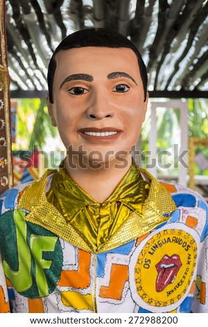OLINDA, BRAZIL - APRIL 26: Portrait of one of the many Olindaâ??s famous carnival costumes dressed in its traditional colorful shirt as seen on April 26, 2015 in Olinda, Pernambuco, Brazil. - stock photo