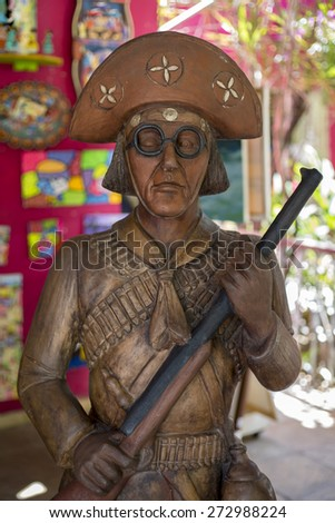 OLINDA, BRAZIL - APRIL 26: Sculpture of the most notorious Pernambuco's outlaw  nicknamed Lampiao who became an icon of the northeast of Brazil as seen on April 26, 2015 in Olinda, Pernambuco, Brazil. - stock photo