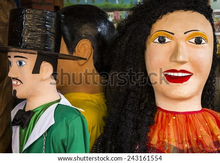 OLINDA, BRAZIL - APRIL 3: the colorful giant dolls of Olinda's carnival festival is not only typical costumes, but landmarks of the state of Pernambuco in Brazil photographed on April 3, 2014. - stock photo