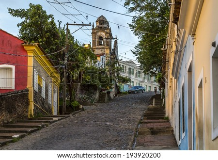 OLINDA, BRAZIL - APRIL 12: The Ladeira da Misericordia Street in Olinda, PE, Brazil with its cobble stones and 17th century buildings hosts the local carnival festival. Photographed on April 12, 2014. - stock photo
