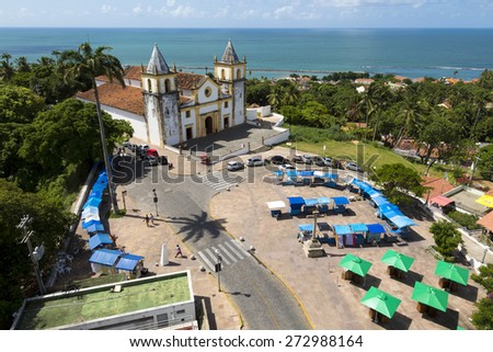 OLINDA, BRAZIL - APRIL 26: View of Olinda in PE, Brazil showcasing its historic site with the famous Se Church and the Atlantic ocean on the background on a sunny and hot summer day of April 26, 2015. - stock photo