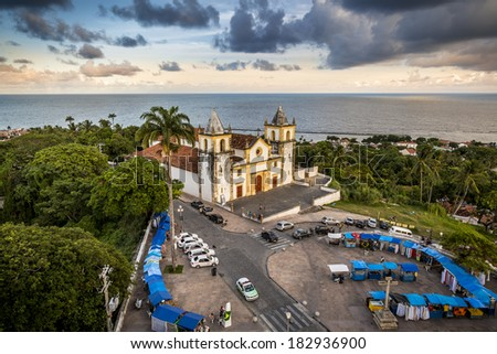OLINDA, BRAZIL - MARCH 17: Aerial view of the historic buildings of Olinda in Pernambuco, Brazil with the Church of Se and handcraft kiosks on March 17, 2014.  - stock photo