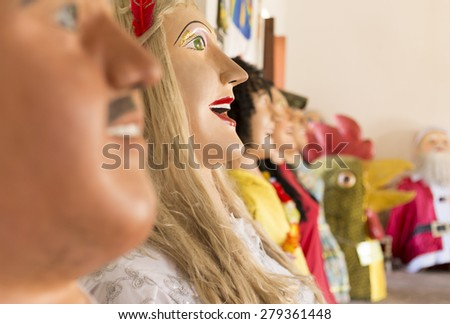 OLINDA, BRAZIL - MARCH 29: Some Brazilian Carnival Festival costumes made of paper, wood, and fabric wore by locals during that one-week celebration photographed on March 29, 2015 in Olinda. - stock photo
