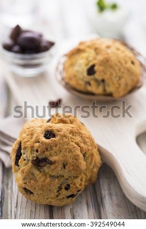 Olive buns on white table - stock photo
