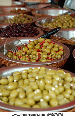 Olive display on market stall - stock photo